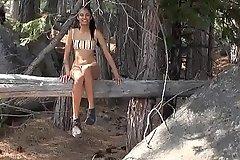 Bikini Babe in arms in Woods