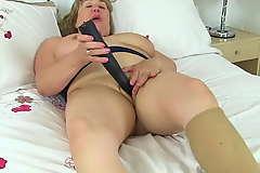 UK milf Aunty Trisha soaks her tights increased by fucks a dildo