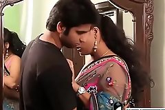 Indian hot teacher close to pink bra and sari seducing young boy -Adulteacher.com