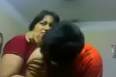 Unprofessional Indian couple kiss sensually close up