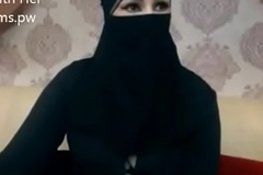 Indian Muslim doll at hand hijab stand chatting primarily webcam